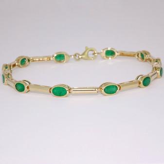 9ct gold oval cut rubover set emerald bracelet