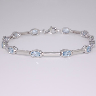 9ct white gold oval cut rubover set aquamarine bracelet