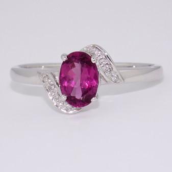 9ct white gold oval cut raspberry garnet and diamond ring