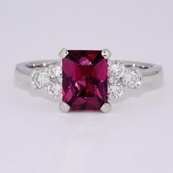 Platinum scissor cut raspberry garnet and round brilliant cut diamond ring