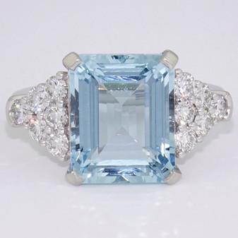 Platinum emerald cut aquamarine and 12 diamond ring