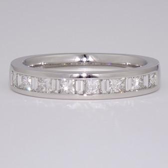 Platinum channel set princess cut and baguette cut diamond ring
