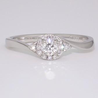 Platinum round brilliant cut diamond cluster twist ring