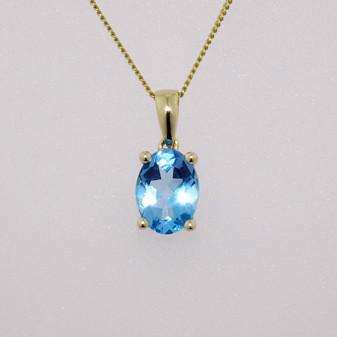 9ct gold oval cut blue topaz pendant