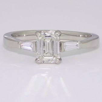 Platinum emerald cut and tapered baguette cut diamond ring
