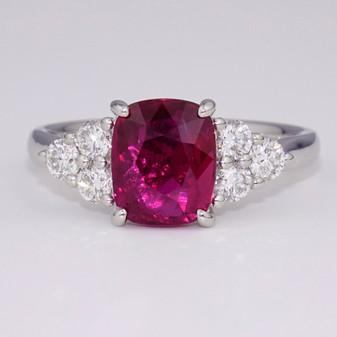 Platinum cushion cut ruby and diamond ring