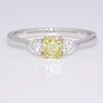 18ct white and yellow gold fancy intense yellow cushion cut diamond trilogy ring