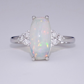 Long cushion cut Ethiopian water opal ring with diamonds