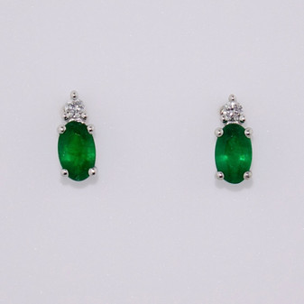 18ct white gold emerald and diamond stud earrings