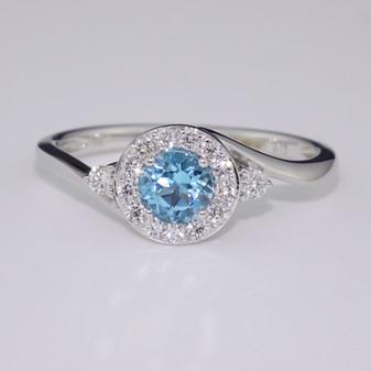 9ct white gold blue topaz and diamond ring