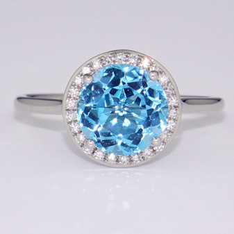 9ct white gold blue topaz and diamond halo ring