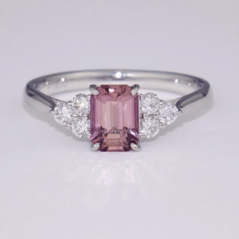 Platinum plum sapphire and diamond ring