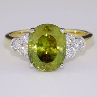18ct gold oval cut sphene and diamond ring