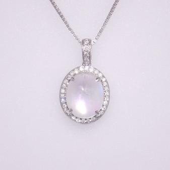 9ct white gold rainbow moonstone and diamond pendant.