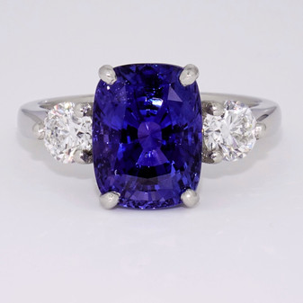 Platinum cushion cut sapphire and round brilliant cut diamond ring
