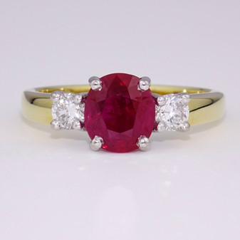 18ct gold oval cut ruby and diamond ring