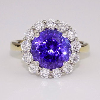 18ct gold round cut tanzanite and round brilliant cut diamond cluster ring