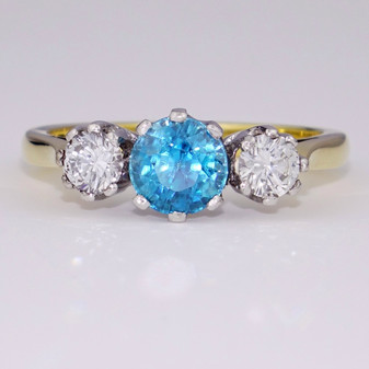 18ct gold blue zircon and round brilliant cut diamond ring