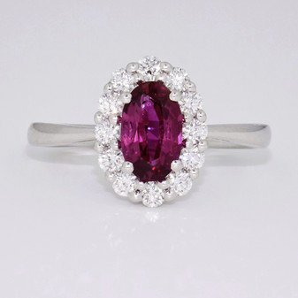 18ct white gold oval cut ruby and round brilliant cut diamond cluster ring