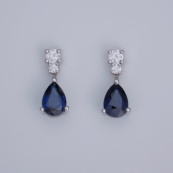 18ct white gold pear cut sapphire and round brilliant cut diamond drop earrings