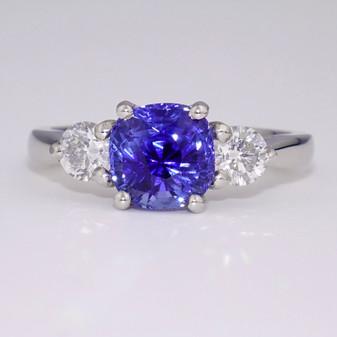 Platinum cushion cut unheated sapphire and diamond three stone ring