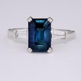 Platinum teal sapphire and diamond ring