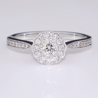 18ct white gold diamond cluster ring with scalloped milgrain edge and tapered shoulders