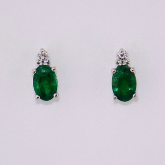 18ct white gold oval cut emerald and diamond earrings