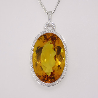 9ct white gold oval cut citrine and diamond pendant