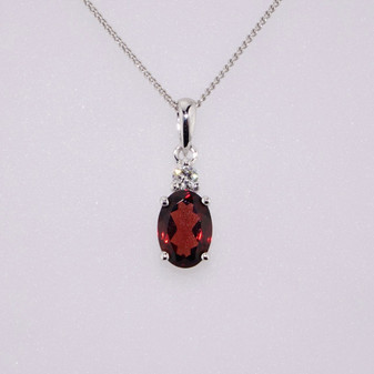 9ct white gold oval cut garnet and diamond pendant