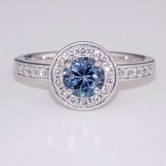 Platinum aquamarine and diamond halo ring