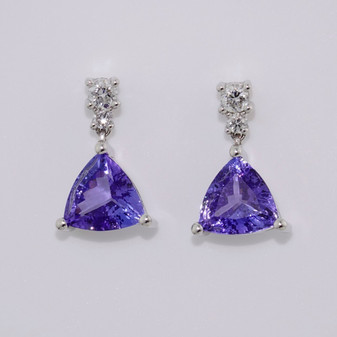18ct white gold trillion cut tanzanite and round brilliant cut diamond drop earrings