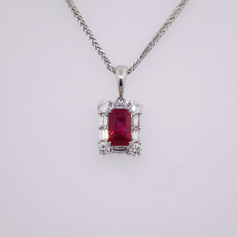 18ct white gold emerald cut ruby and baguette and round cut diamond pendant