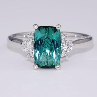 Unique platinum cushion cut tourmaline and round brilliant cut diamond ring