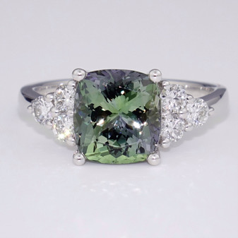 Platinum cushion cut green tanzanite and round brilliant cut diamond ring