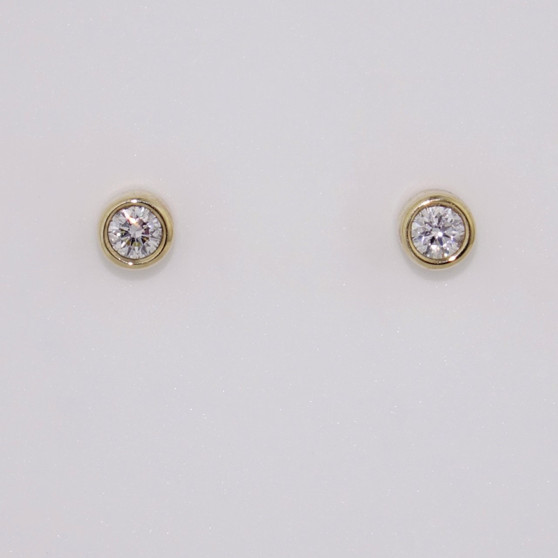 9ct yellow gold small diamond stud earrings in a rubover setting ER10783