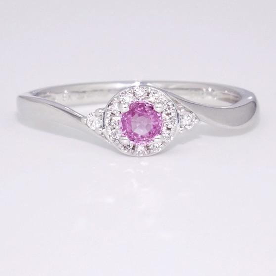 Pink sapphire and diamond twist ring