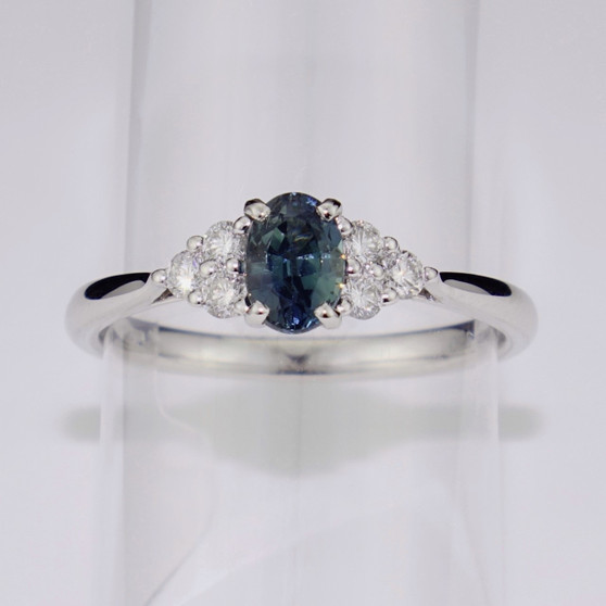 Platinum teal sapphire and diamond ring