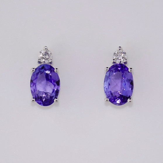 18ct white gold oval cut tanzanite and round brilliant cut diamond stud earrings