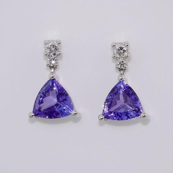 18ct white gold trillion cut tanzanite and round brilliant cut diamond drop earrings