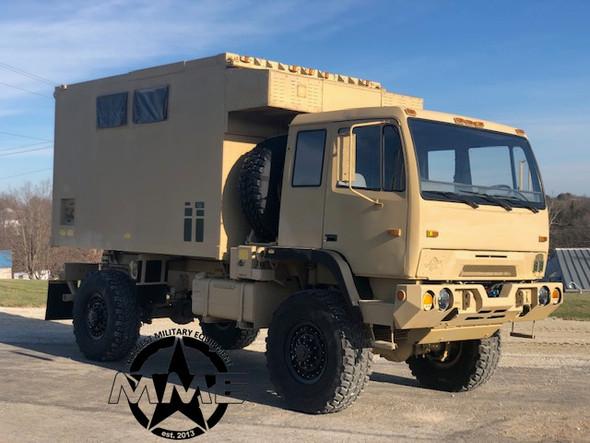 1998 BAE M1079 2 1/2 Ton LMTV 4x4 Camper Truck.