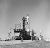 1965 - Overall view of the Gemini-Titan 3 on Launch Pad 19, Cape Canaveral, Florida. The GT-3 liftoff was on March 23, 1965. A photographer stands at bottom of launch pad with a movie camera. Poster Print - Item # VARPSTSTK203911S