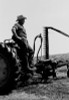USA  Farmer standing on tractor and looking away Poster Print - Item # VARSAL255424569