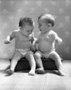 1930s-1940s Twin Babies Wearing Diapers Together Sitting On A Bench Side By Side Studio Print By Vintage Collection - Item # VARPPI177165