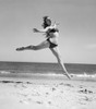 1950s Woman In Bikini Running And Jumping On The Beach Smiling Poster Print By Vintage Collection (32 X 36) - Item # PPI177103LARGE
