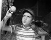 1950s Boy In Tee-Shirt And Cap Removing Baseball From Broken Window Poster Print By Vintage Collection - Item # VARPPI177040