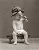 1940s Baby Sherlock Holmes In Diaper Sitting On Bench Wearing Deer Stalker Hat Looking Through Magnifying Glass Print By - Item # VARPPI177729