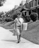 1930s Boy Newsboy Looking At Camera Delivering Newspapers Walking Along Suburban Street Of Row Houses Print By Vintage - Item # VARPPI177436