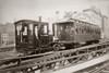 1880s Men On Board Elevated Locomotive & Passenger Car On East 42Nd Street Grand Union Hotel In Background New York City - Item # VARPPI195700