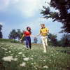 1960s-1970s Young Teenage Couple Holding Hands Running Through Field Of Queen Anne'S Lace Wild Flowers Print By Vintage - Item # PPI177481LARGE